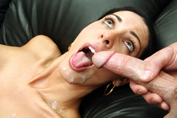 Busty milf takes a load in her face